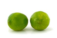 Two green limes isolated on white background