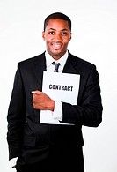 Happy businessman holding a contract and smiling at the camera