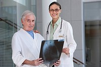 doctor and patient looking at xray scans
