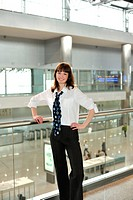 business young woman standing in office environment