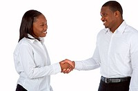 African_American businesswoman shakes hands with businessman