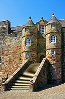 Front access stairway at 16th Century Rowallan Castle, Kilmaurs, Ayrshire, Scotland, showing the twin turrets and coat of arm above the doorway