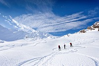 Ski hikers climbing Mt. Staudenberg Joechl in Ridnaun above Schneeberg, behind Mt. Staudenberg Joechl, Sterzing, South Tyrol, Italy, Europe