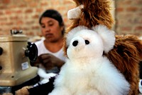 Woman at a sewing machine, production of soft toys and carpets from alpaca fur in a small family business, Pachamac, Lima, Peru, South America