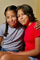Two preteen girls, members of the Acjachemen tribe of Southern California, pose happily together