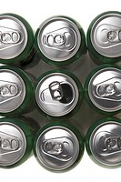 Macro shot of the tops of a bunch of aluminum cans with opened one