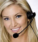 Attractive customer service agent talking on phone headset.