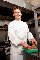 Male Chef Preparing Vegetables In Restaurant Kitchen