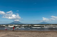 Shallow shore of the Lago de Nicaragua with the volcanic island of Ometepe and the stratovolcanoes Volcán Concepción, left, and Volcán Maderas, right,...