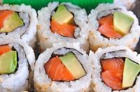 salmon and avocado sushi close up