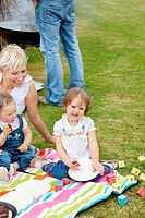 Caucasian family having a picnic together in a park