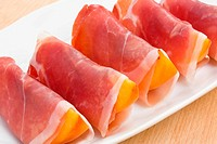 Slices of peach in Prosciutto Italian cured ham