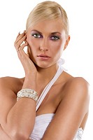 beautiful blond woman in white with silver bracelet jewellery and fashion make up isolated on white