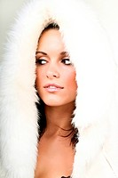 Young seductive woman in white fur