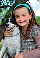 smiling little girl and her jack russel terrrier
