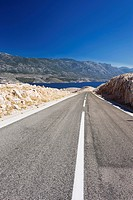 Road through karst landscape in Zigljen, Pag island, Dalmatia, Croatia, Europe