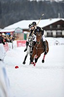 Matthias Maiquez of team Valartis Bank followed by Marie-Jeanette Ferch of team Parmigiani, polo played on snow, polo tournament, Valartis Snow Polo W...