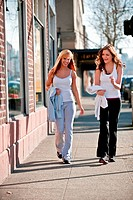 Two young Caucasian women working out outside