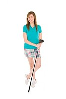 Beautiful Caucasian teenage girl posing with golf equipment