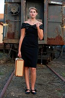 Woman, suitcase, train tracks, vintage look