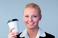 Smiling business woman holding a coffee cup
