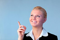 Young Happy Businesswoman pointing upwards