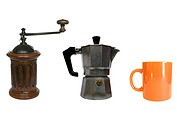 Traditional Italian coffee tools including miller, percolator and mug cup
