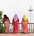 Three Muslim women on St Paul's Hill in Melaka, Malaysia