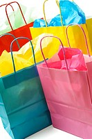 A shot of colorful shopping bags on white