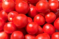 red tomatoes on the market closeup