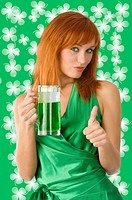 cute irish girl posing in green dress in positive expression with green beer