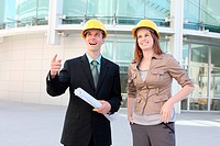 Attractive Man and woman team on a building construction site