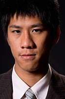 Closeup portrait of Asian young business man.