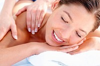 Young woman pampering herself with a body massage