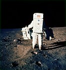 Astronaut Edwin ´Buzz´ Aldrin carrying components of the Early Apollo Scientific Experiments Package EASEP__the Passive Seismic Experiments Package le...