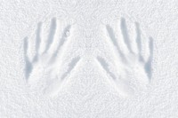 hands impression in fresh snow