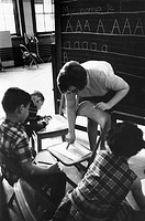 First graders being taught by a VISTA volunteer in Chicago, Illinois. Photograph, c1970.
