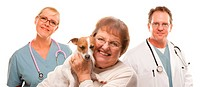 Happy Senior Woman with Dog and Veterinarian and Nurse Isolated on a White Background.