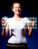 smiling woman is typing on virtual keyboard