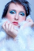 cold tint portrait of beautiful brunette woman in white fur coat