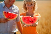 people eat watermelon and enjoy