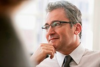 Mature businessman looking away and thinking