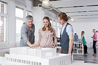 Germany, Bavaria, Munich, Man explaining architectural model to colleagues