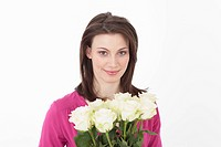 Young woman with roses, smiling, portrait