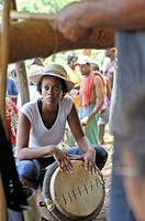 woman playing drums, Fonds-Saint-Denis, Martinique, french island overseas region and department in the Lesser Antilles in the eastern Caribbean Sea, ...