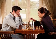 A man and woman playing chess (thumbnail)