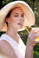 Woman drinking a beer (thumbnail)