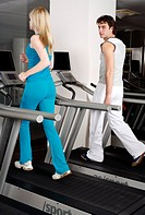 Young woman and man on treadmill (thumbnail)