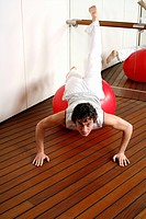 Young man performing a pilates exercise