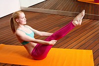 Young woman performing a pilates stretch